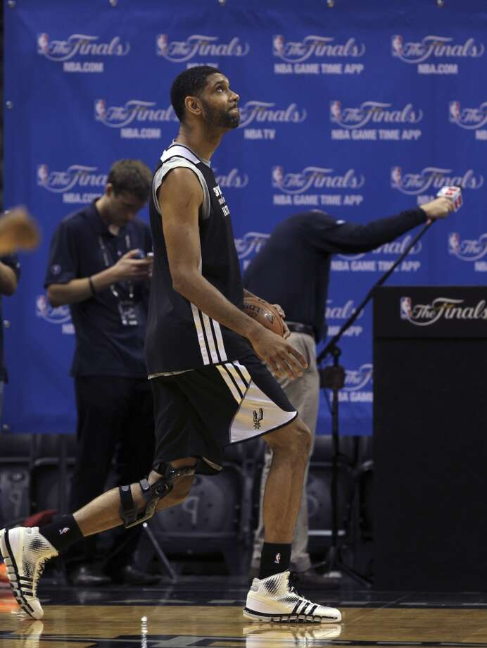 San Antonio Spurs' Tim Duncan stretches during practice at the AT&T Center, Wednesday, June 4, 2014. The Spurs will play the Miami Heat in the NBA Finals starting on Thursday in San Antonio. Photo: Jerry Lara, San Antonio Express-News
