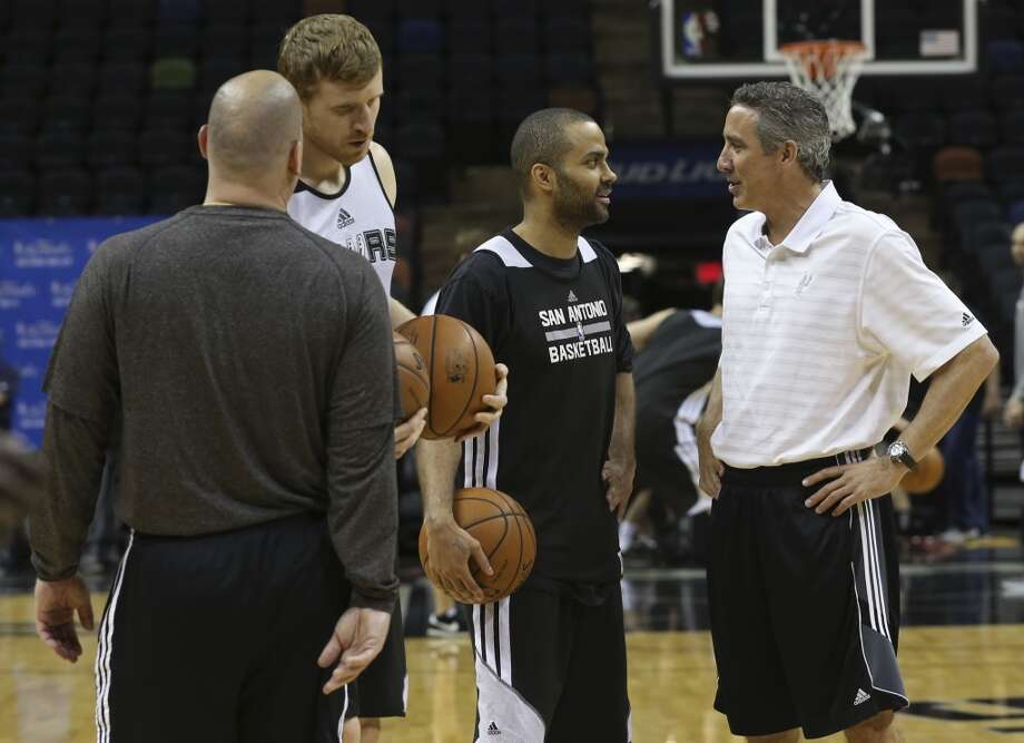 San Antonio Spurs' Tony Parker talks with assistant coach Chip Engelland during practice at the AT&T Center, Wednesday, June 4, 2014. The Spurs will play the Miami Heat in the NBA Finals starting on Thursday. Photo: Jerry Lara, San Antonio Express-News