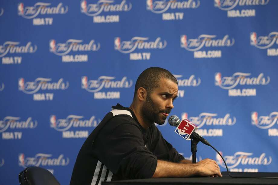San Antonio Spurs' Tony Parker talks with the media after practice at the AT&T Center, Wednesday, June 4, 2014. The Spurs will play the Miami Heat in the NBA Finals starting Thursday. Photo: Jerry Lara, San Antonio Express-News