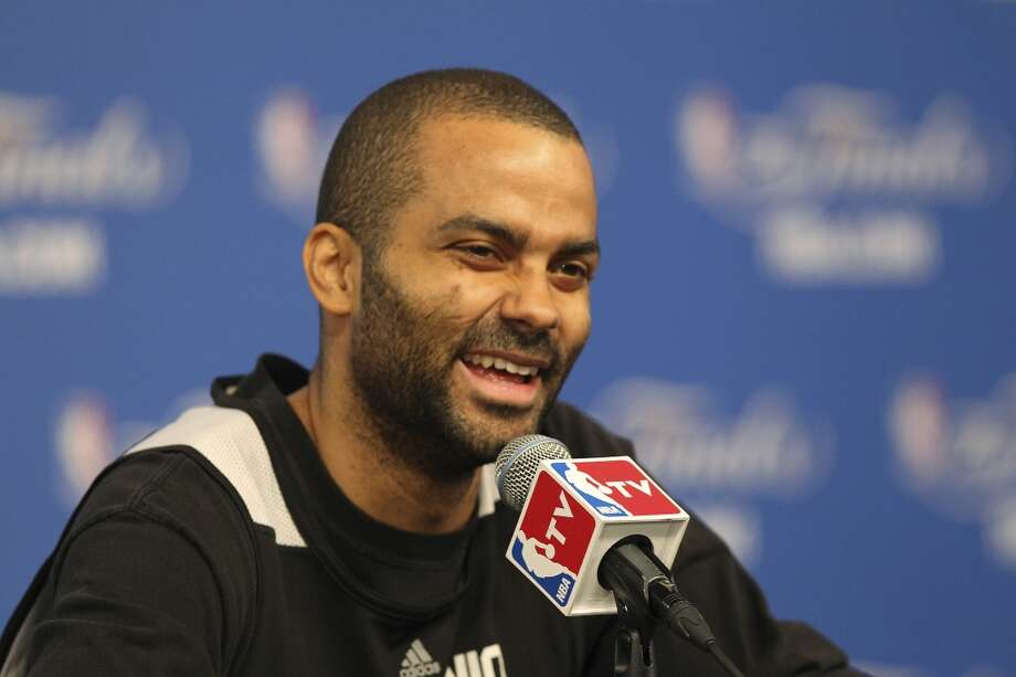San Antonio Spurs' Tony Parker smiles while talks with media after practice at the AT&T Center, Wednesday, June 4, 2014. The Spurs will play the Miami Heat in the NBA Finals starting on Thursday. Photo: Jerry Lara, San Antonio Express-News