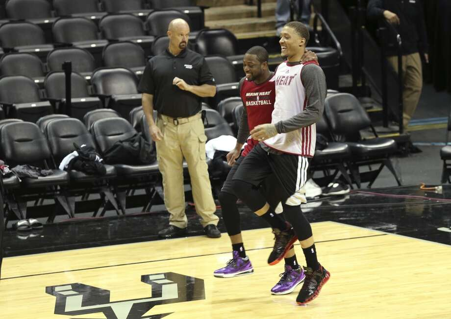 Miami Heat's Dwyane Wade and Michael Beasley jokes around during practice at the AT&T Center, Wednesday, June 4, 2014. The Heat will play the San Antonio Spurs in the NBA Finals starting on Thursday. Photo: Jerry Lara, San Antonio Express-News