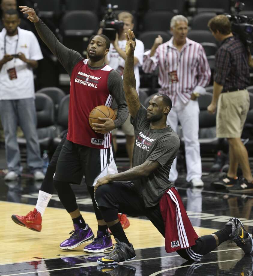 Miami Heat's Dwyane Wade and LeBron James stretch out during practice at the AT&T Center, Wednesday, June 4, 2014. The Heat will play the San Antonio Spurs in the NBA Finals starting on Thursday. Photo: Jerry Lara, San Antonio Express-News