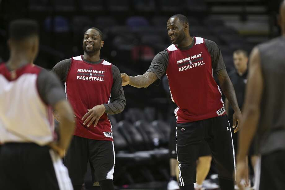 Miami Heat's Dwyane Wade, left, jokes around with LeBron James during practice at the AT&T Center, Wednesday, June 4, 2014. The Heat will play the San Antonio Spurs in the NBA Finals starting on Thursday. Photo: Jerry Lara, San Antonio Express-News