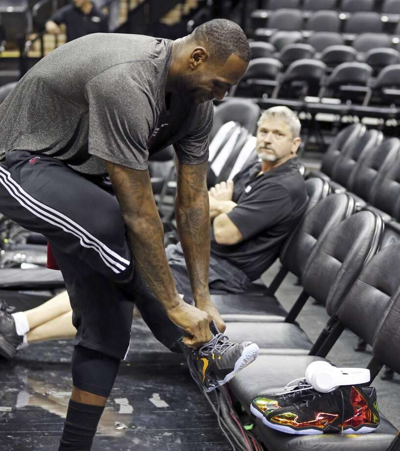Miami Heat's LeBron James changes shoes during practice Wednesday, June 4, 2014, at the AT&T Center. The Spurs will play the Miami Heat in Game 1 of the NBA Finals Thursday at the AT&T Center. Photo: Edward A. Ornelas, San Antonio Express-News
