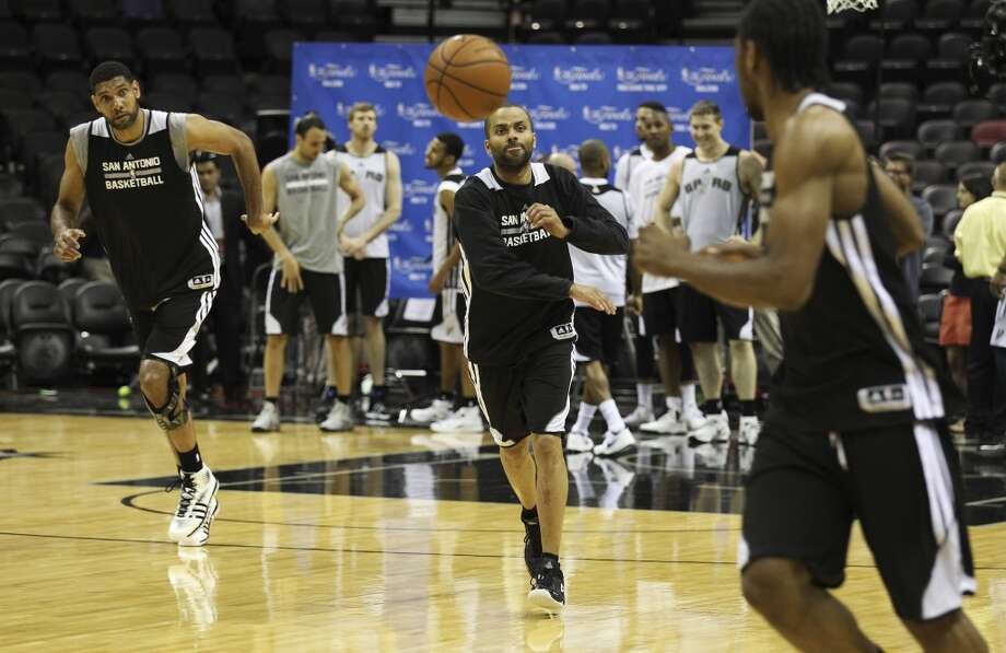 Spurs' Tim Duncan (from left), Tony Parker and Kawhi Leonard practice during the NBA Finals practice and media session at the AT&T Center on Wednesday, June 4, 2014. The Spurs will play Game 1 of the Finals against the Miami Heat on Thursday. Photo: Kin Man Hui, San Antonio Express-News