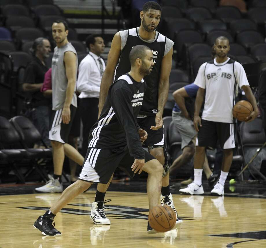 Spurs' Tony Parker and Tim Duncan take part in practice during the NBA Finals practice and media session at the AT&T Center on Wednesday, June 4, 2014. The Spurs will play Game 1 of the Finals against the Miami Heat on Thursday. Photo: Kin Man Hui, San Antonio Express-News