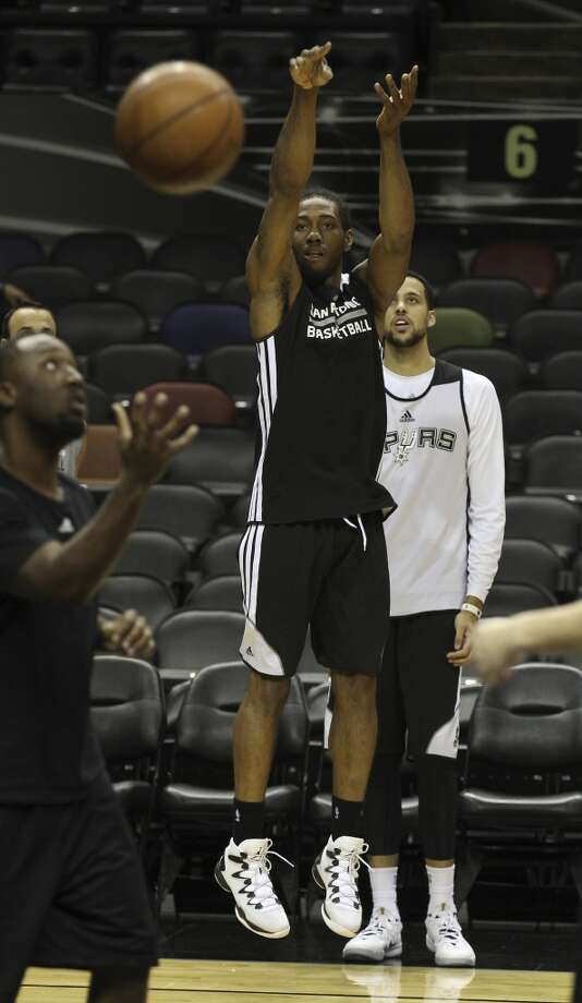 Spurs' Kawhi Leonard takes a shot during the NBA Finals practice and media session at the AT&T Center on Wednesday, June 4, 2014. The Spurs will play Game 1 of the Finals against the Miami Heat on Thursday. Photo: Kin Man Hui, San Antonio Express-News