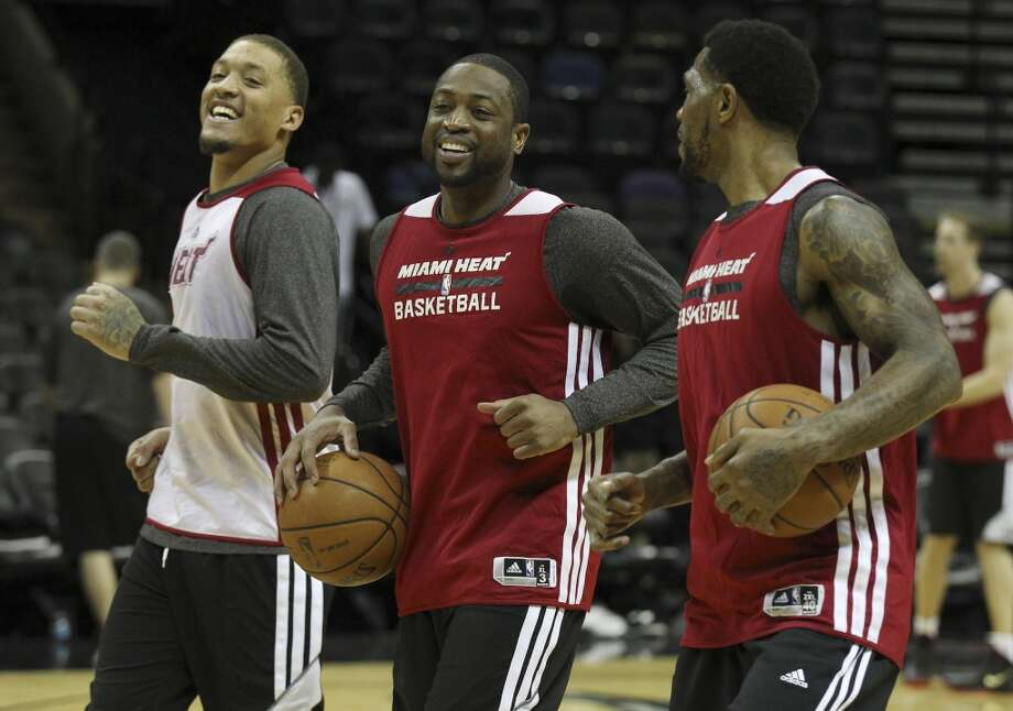 Miami Heats' Michael Beasley (from left), Dwyane Wade and Udonis Haslem work out during the NBA Finals practice and media session at the AT&T Center on Wednesday, June 4, 2014. The Heat will play Game 1 of the Finals against the Spurs on Thursday. Photo: Kin Man Hui, San Antonio Express-News