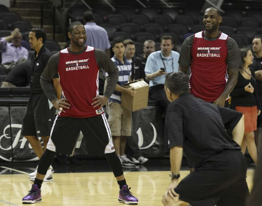 Miami Heats' Dwyane Wade and LeBron James work out during the NBA Finals practice and media session at the AT&T Center on Wednesday, June 4, 2014. The Heat will play Game 1 of the Finals against the Spurs on Thursday. Photo: Kin Man Hui, San Antonio Express-News