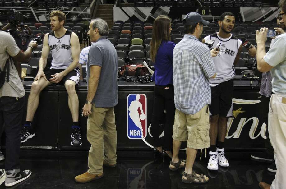 Spurs' Matt Bonner (left) and Cory Joseph take questions from the media during the NBA Finals practice and media session at the AT&T Center on Wednesday, June 4, 2014. The Spurs will play Game 1 of the Finals against the Miami Heat on Thursday. Photo: Kin Man Hui, San Antonio Express-News