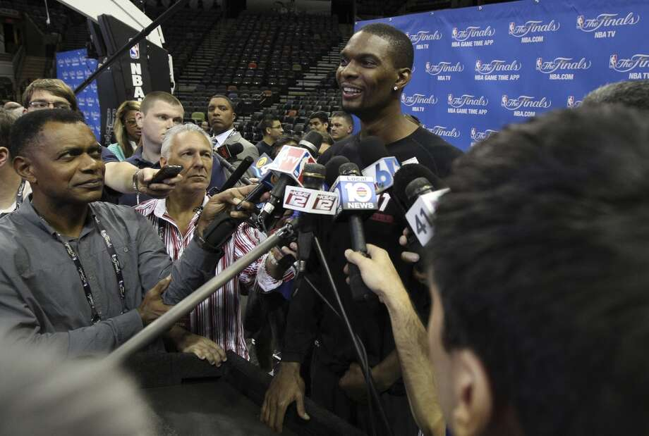 Miami Heat's Chris Bosh answers question from the media during the NBA Finals practice and media session at the AT&T Center on Wednesday, June 4, 2014. The Spurs will play Game 1 of the Finals against the Miami Heat on Thursday. Photo: Kin Man Hui, San Antonio Express-News