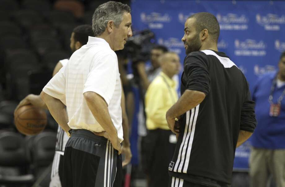 Spurs assistant coach Chip Engelland (left) and point guard Tony Parker chat during the NBA Finals practice and media session at the AT&T Center on Wednesday, June 4, 2014. The Spurs will play Game 1 of the Finals against the Miami Heat on Thursday. Photo: Kin Man Hui, San Antonio Express-News