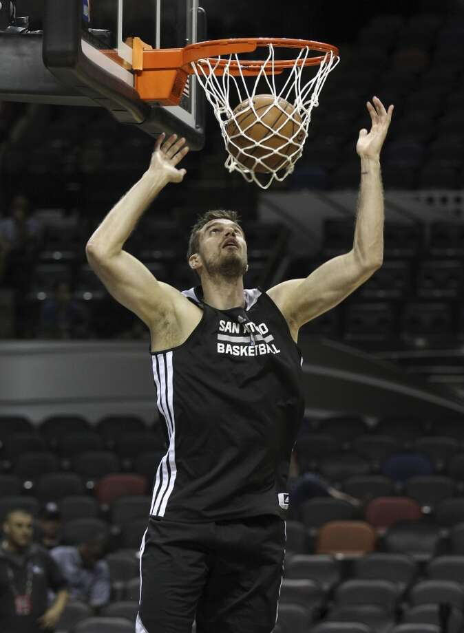 Spurs' Tiago Splitter watches his layup during the NBA Finals practice and media session at the AT&T Center on Wednesday, June 4, 2014. The Spurs will play Game 1 of the Finals against the Miami Heat on Thursday. Photo: Kin Man Hui, San Antonio Express-News