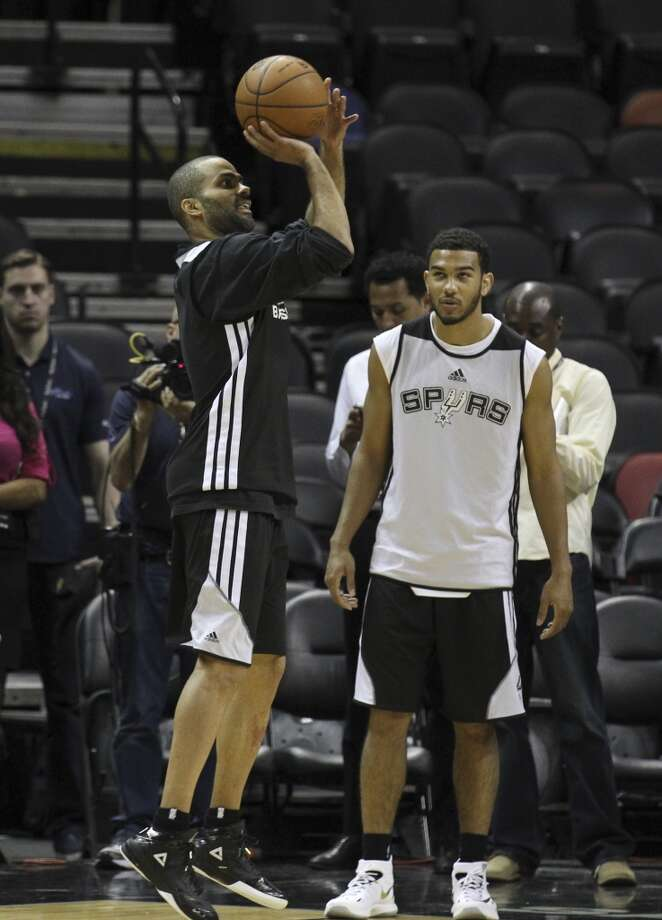 Spurs' Tony Parker and Cory Joseph take part in drills during the NBA Finals practice and media session at the AT&T Center on Wednesday, June 4, 2014. The Spurs will play Game 1 of the Finals against the Miami Heat on Thursday. Photo: Kin Man Hui, San Antonio Express-News