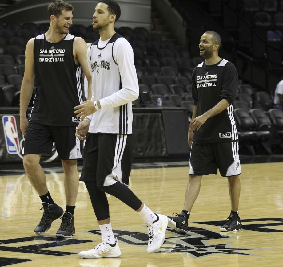 Spurs' Tony Parker (right) laughs with teammate Tiago Splitter during the NBA Finals practice and media session at the AT&T Center on Wednesday, June 4, 2014. The Spurs will play Game 1 of the Finals against the Miami Heat on Thursday. Photo: Kin Man Hui, San Antonio Express-News