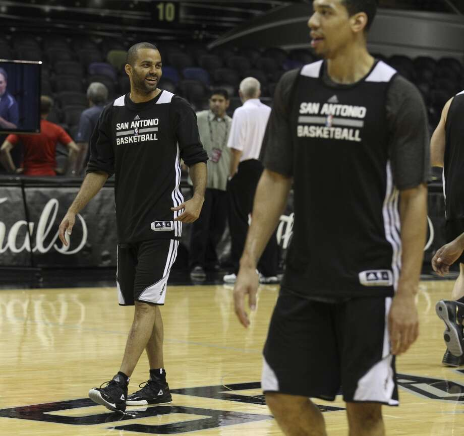 Spurs' Tony Parker (left) laughs with teammates during the NBA Finals practice and media session at the AT&T Center on Wednesday, June 4, 2014. The Spurs will play Game 1 of the Finals against the Miami Heat on Thursday. Photo: Kin Man Hui, San Antonio Express-News