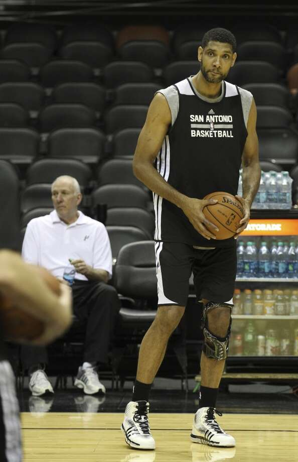 Spurs' Tim Duncan warms up on the floor during the NBA Finals practice and media session at the AT&T Center on Wednesday, June 4, 2014. The Spurs will play Game 1 of the Finals against the Miami Heat on Thursday. Photo: Kin Man Hui, San Antonio Express-News