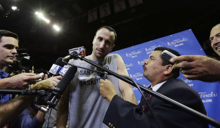 San Antonio Spurs guard Manu Ginobili, center, takes questions after practice on Wednesday, June 4, 2014, in San Antonio. The Spurs play Game 1 of the NBA Finals against the Miami Heat on Thursday. Photo: Eric Gay, Associated Press