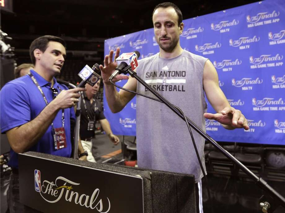 San Antonio Spurs guard Manu Ginobili, right, prepares to take questions after basketball practice on Wednesday, June 4, 2014, in San Antonio. The Spurs play Game 1 of the NBA Finals against the Miami Heat on Thursday. Photo: Eric Gay, Associated Press
