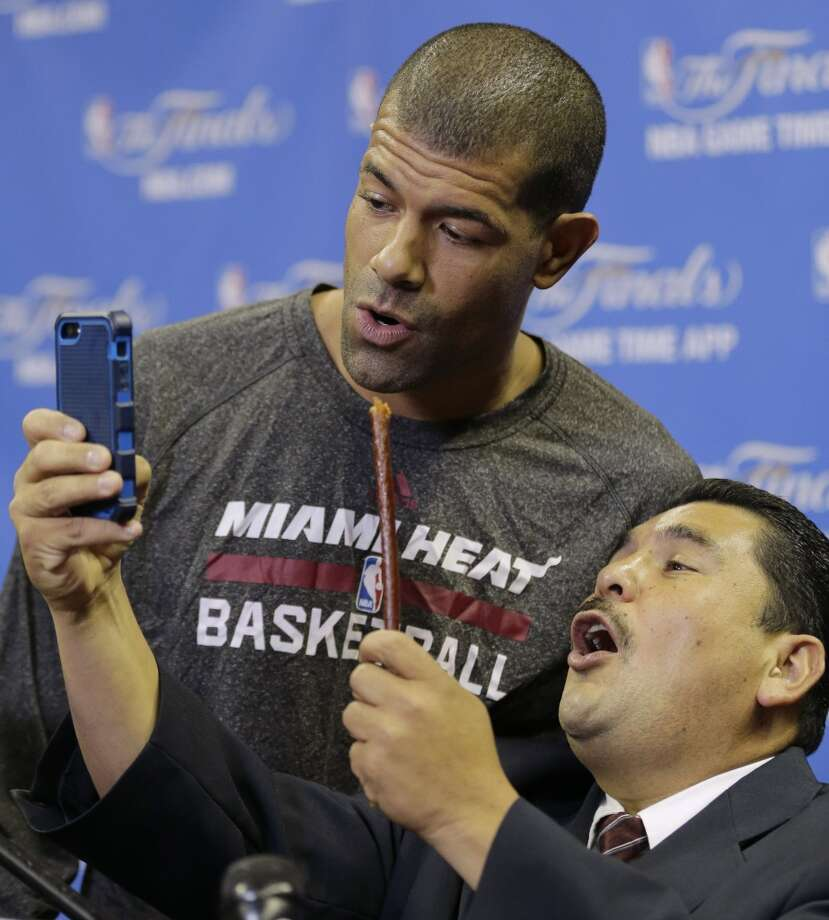 Miami Heat forward Shane Battier sings with a late show personality Guillermo Rodriguez after basketball practice on Wednesday, June 4, 2014, in San Antonio. The Spurs play Game 1 of the NBA Finals on Thursday. Photo: Eric Gay, Associated Press