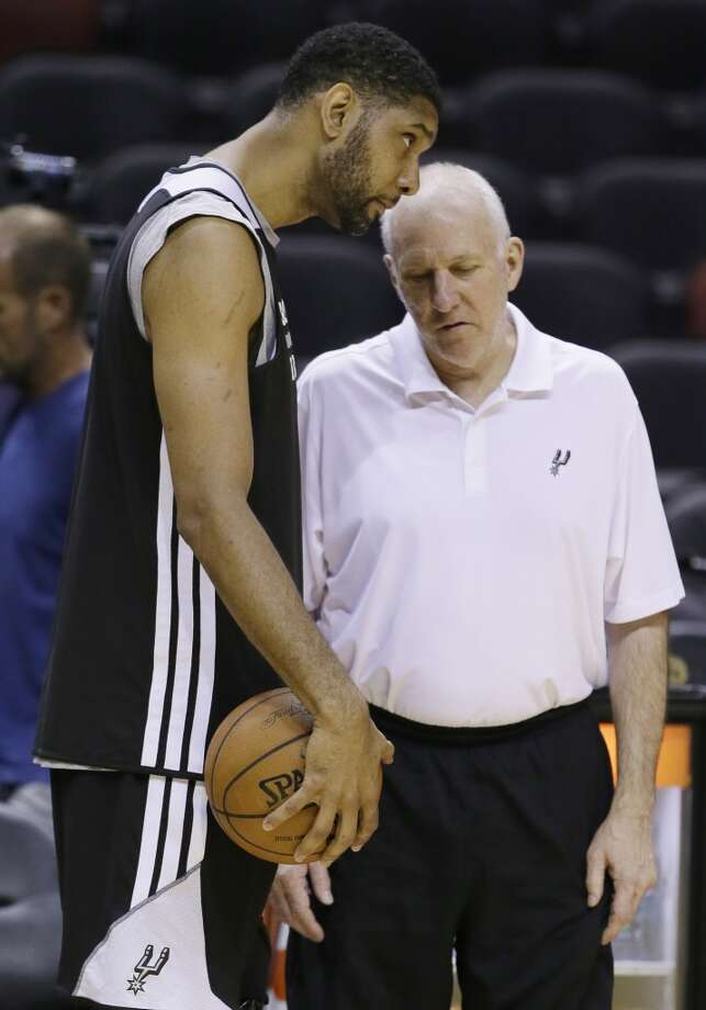 San Antonio Spurs forward Tim Duncan, left and head coach Gregg Popovich talk during basketball practice on Wednesday, June 4, 2014, in San Antonio. The Spurs play Game 1 of the NBA Finals against the Miami Heat on Thursday. Photo: Tony Gutierrez, Associated Press