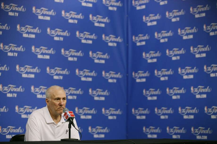 San Antonio Spurs head coach Gregg Popovich listens to a question after basketball practice on Wednesday, June 4, 2014, in San Antonio. The Spurs play Game 1 of the NBA Finals against the Miami Heat on Thursday. Photo: Tony Gutierrez, Associated Press
