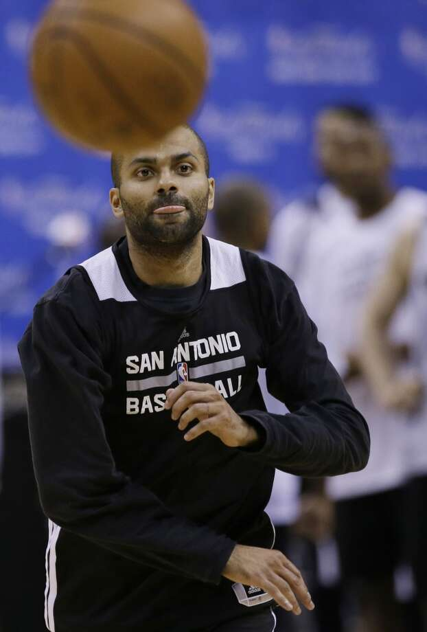 San Antonio Spurs guard Tony Parker passes the ball during basketball practice on Wednesday, June 4, 2014, in San Antonio. The Spurs play Game 1 of the NBA Finals against the Miami Heat on Thursday. Photo: Tony Gutierrez, Associated Press