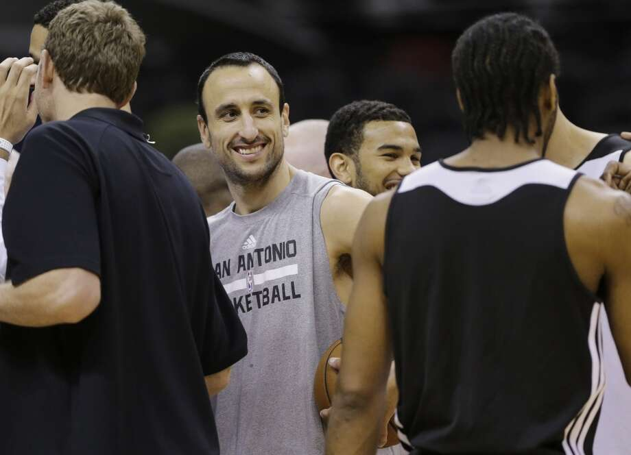 San Antonio Spurs guard Manu Ginobili smiles at the end of basketball practice on Wednesday, June 4, 2014, in San Antonio. The Spurs play Game 1 of the NBA Finals against the Miami Heat on Thursday. Photo: Eric Gay, Associated Press
