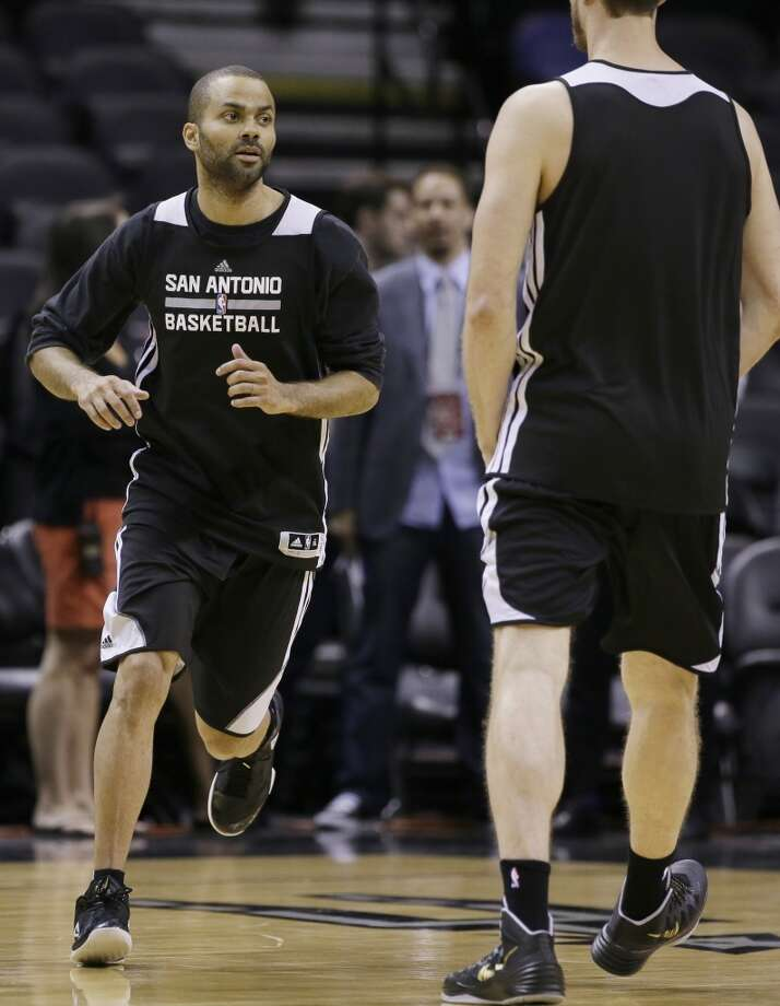 San Antonio Spurs guard Tony Parker runs a drill during basketball practice on Wednesday, June 4, 2014, in San Antonio. The Spurs play Game 1 of the NBA Finals against the Miami Heat on Thursday. Photo: Tony Gutierrez, Associated Press
