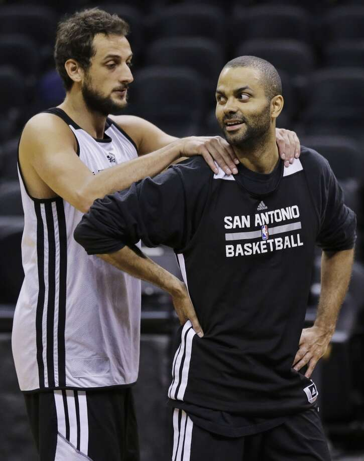San Antonio Spurs guard Marco Belinelli, left,  and guard Tony Parker joke around during basketball practice on Wednesday, June 4, 2014, in San Antonio. The Spurs play Game 1 of the NBA Finals against the Miami Heat on Thursday. Photo: Eric Gay, Associated Press