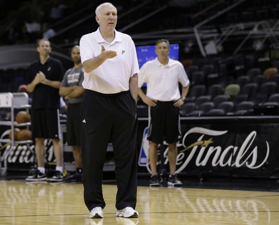San Antonio Spurs head coach Gregg Popovich leads basketball practice on Wednesday, June 4, 2014, in San Antonio. The Spurs play Game 1 of the NBA Finals against the Miami Heat on Thursday. Photo: Eric Gay, Associated Press