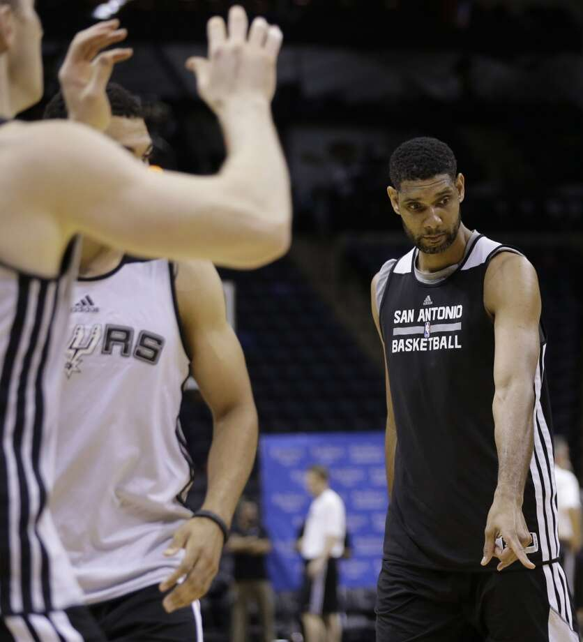San Antonio Spurs forward Tim Duncan runs a through a drill during basketball practice on Wednesday, June 4, 2014, in San Antonio. The Spurs play Game 1 of the NBA Finals against the Miami Heat on Thursday. Photo: Eric Gay, Associated Press