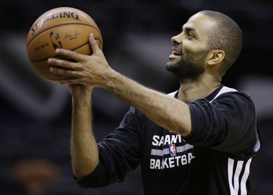 San Antonio Spurs guard Tony Parker shoots the ball during basketball practice on Wednesday, June 4, 2014, in San Antonio. The Spurs play Game 1 of the NBA Finals against the Miami Heat on Thursday. Photo: Tony Gutierrez, Associated Press