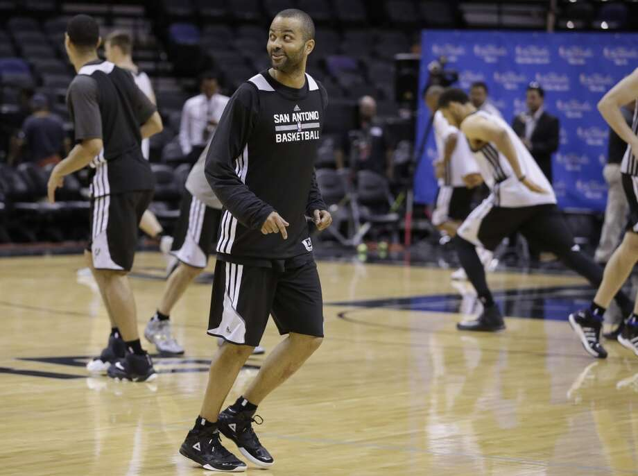 San Antonio Spurs guard Tony Parker warms up for basketball practice on Wednesday, June 4, 2014, in San Antonio. The Spurs play Game 1 of the NBA Finals against the Miami Heat on Thursday. Photo: Tony Gutierrez, Associated Press