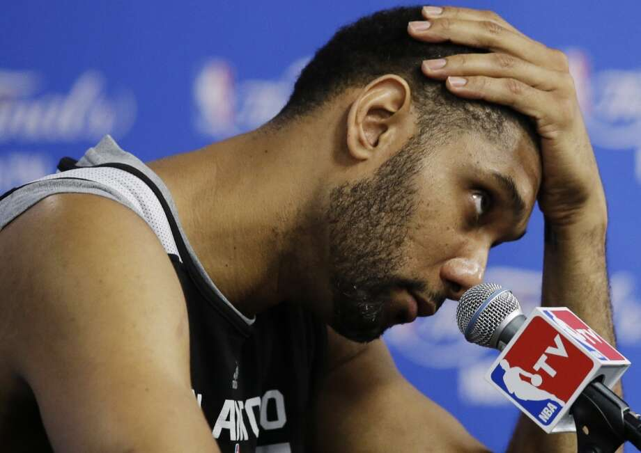 San Antonio Spurs forward Tim Duncan takes questions during a news conference after basketball practice on Wednesday, June 4, 2014, in San Antonio. The Spurs play Game 1 of the NBA Finals against the Miami Heat on Thursday. Photo: Tony Gutierrez, Associated Press