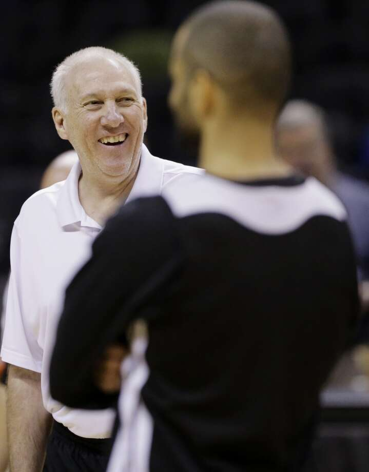 San Antonio Spurs head coach Gregg Popovich smiles during basketball practice on Wednesday, June 4, 2014, in San Antonio. The Spurs play Game 1 of the NBA Finals against the Miami Heat on Thursday. Photo: Eric Gay, Associated Press