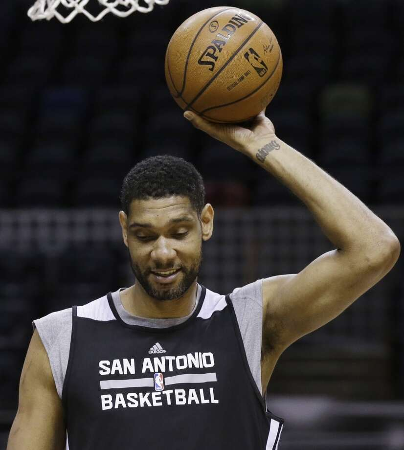 San Antonio Spurs forward Tim Duncan grabs the ball during basketball practice on Wednesday, June 4, 2014, in San Antonio. The Spurs play Game 1 of the NBA Finals against the Miami Heat on Thursday. Photo: Tony Gutierrez, Associated Press