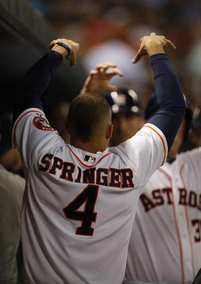 Astros right fielder George Springer (4) celebrates Matt Dominguez's run scored on an RBI single by Astros left fielder Robbie Grossman. Photo: Karen Warren, Houston Chronicle