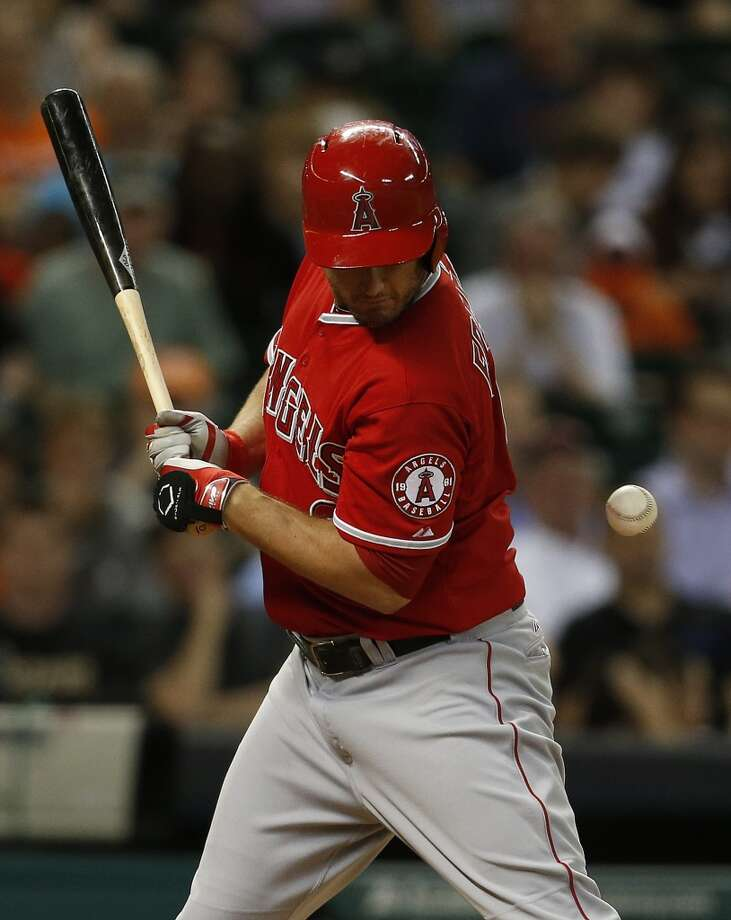 Angels third baseman David Freese (6) is hit by a pitch. Photo: Karen Warren, Houston Chronicle