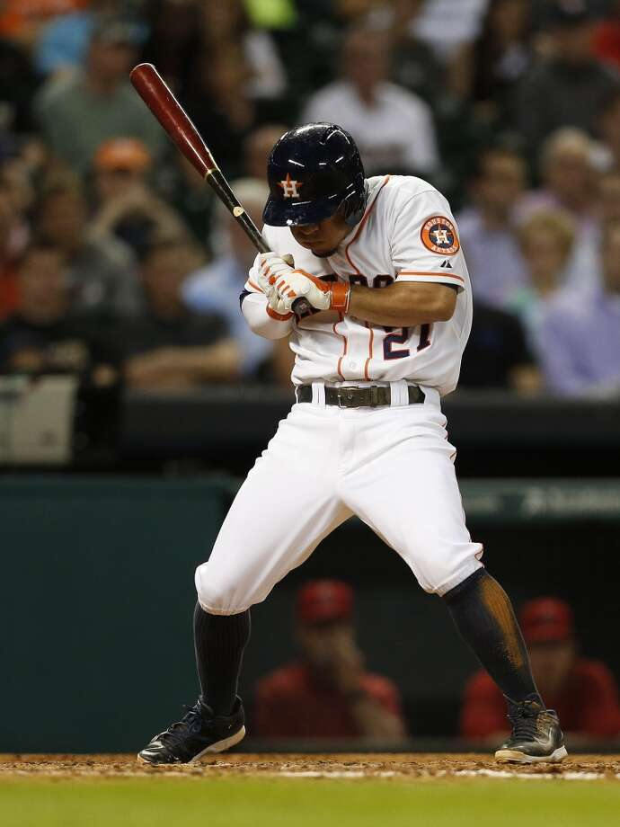 Astros second baseman Jose Altuve (27) jumps back from a ball. Photo: Karen Warren, Houston Chronicle