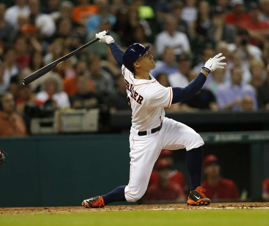 Astros right fielder George Springer (4) flies out to Angels left fielder Josh Hamilton. Photo: Karen Warren, Houston Chronicle