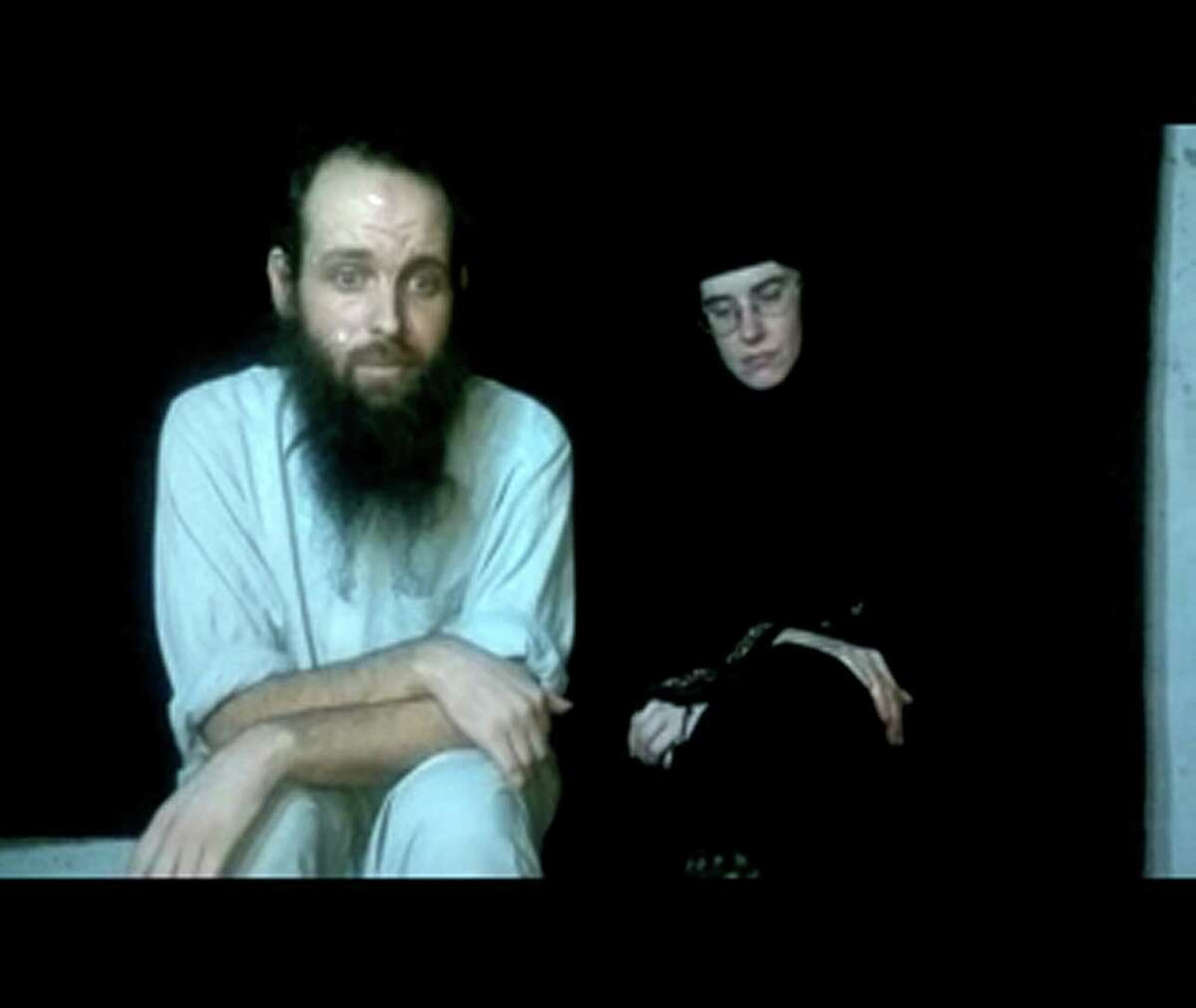 This frame grab from video provided by the Coleman family shows Caitlan Coleman and Joshua Boyle. The family of a then-pregnant American woman who went missing in Afghanistan in late 2012 with her Canadian husband received two videos last year in which the couple asked the U.S. government to help free them from their Taliban captors, The Associated Press has learned. The videos offer the first and only clue about what happened to Caitlan Coleman and Joshua Boyle after they lost touch with their family 20 months ago while traveling in a mountainous region near the capital, Kabul. U.S. law enforcement officials investigating the couple?'s disappearance consider the videos authentic but caution that they hold limited investigative value, since it?'s not clear when or where they were filmed. (AP Photo/Coleman Family) ORG XMIT: WX202