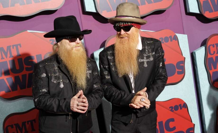 Dusty Hill, left, and Billy Gibbons of the musical group ZZ Top arrive at the CMT Music Awards at Bridgestone Arena on Wednesday, June 4, 2014, in Nashville, Tenn. Photo: Wade Payne, Associated Press