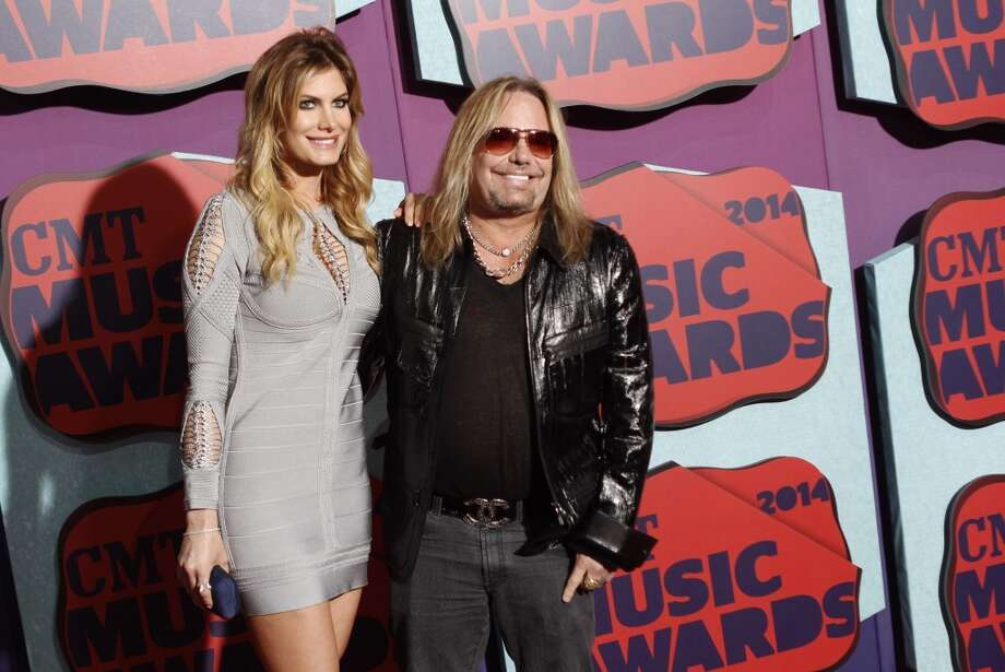 Rain Andreani and Vince Neil arrive at the CMT Music Awards at Bridgestone Arena on Wednesday, June 4, 2014, in Nashville,Tenn. Photo: Wade Payne, Associated Press