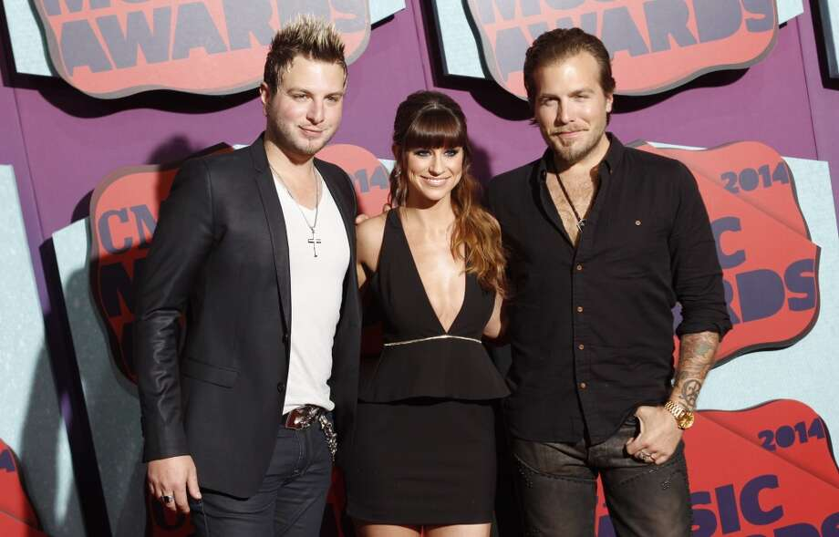 Mike Gossin, from left, Rachel Reinert and Tom Gossin of the musical group Gloriana arrive at the CMT Music Awards at Bridgestone Arena on Wednesday, June 4, 2014, in Nashville, Tenn. Photo: Wade Payne, Associated Press