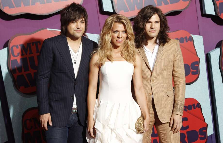Neil Perry, from left, Kimberly Perry and Reid Perry of the musical group The Band Perry arrive at the CMT Music Awards at Bridgestone Arena on Wednesday, June 4, 2014, in Nashville, Tenn. Photo: Wade Payne, Associated Press