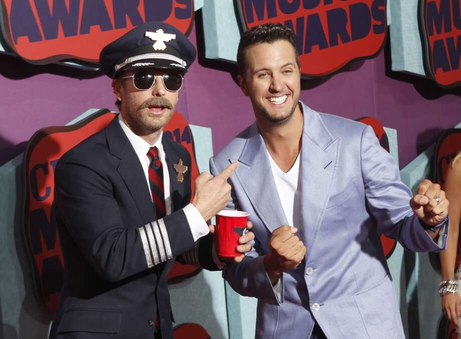 Dierks Bentley, left, and Luke Bryan arrive at CMT Awards arrival at Bridgestone Arena on Wednesday, June 4, 2014, in Nashville, Tenn. Photo: Wade Payne, Associated Press