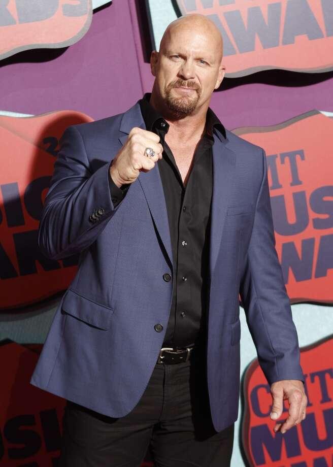 Steve Austin arrives at the CMT Music Awards at Bridgestone Arena on Wednesday, June 4, 2014, in Nashville, Tenn. Photo: Wade Payne, Associated Press