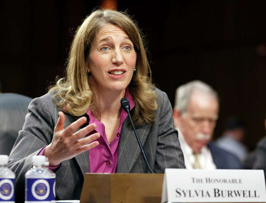 FILE - This May 14, 2014 file photo shows Sylvia Mathews Burwell, President Barack Obama's nominee to become secretary of Health and Human Services testifying on Capitol Hill in Washington. More than 2 million people who got health insurance under President Barack Obama's law have data discrepancies that could jeopardize coverage for some, a government document shows. On Wednesday, Burwell easily passed a key test vote in the Senate. (AP Photo/J. Scott Applewhite, File) ORG XMIT: WX103 Photo: J. Scott Applewhite - AP Photos / AP