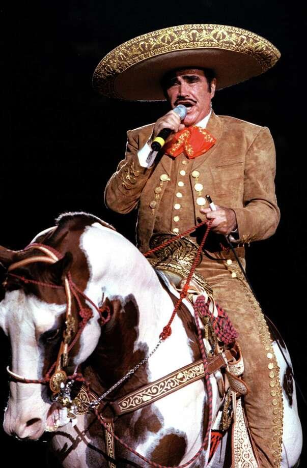 Vicente Fernandez performs at Freeman Coliseum in San Antonio, Texas, on Aug. 29, 1999. Photo: EDWARD A. ORNELAS, San Antonio Express-News / SAN ANTONIO EXPRESS-NEWS